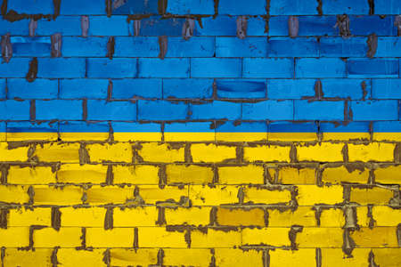 The national flag of Ukraine painted on a wall of sibit blocks with cement. The symbol of the country.