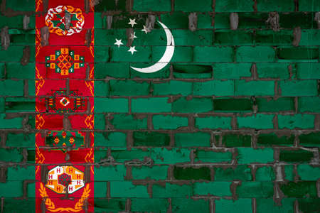 The national flag of Turkmenistan painted on a wall of sibit blocks with cement. The symbol of the country.