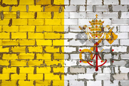 The national flag of Vatican painted on a wall of sibit blocks with cement. The symbol of the country. 스톡 콘텐츠