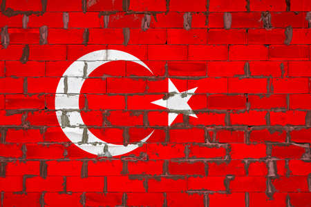 The national flag of Turkey painted on a wall of sibit blocks with cement. The symbol of the country.