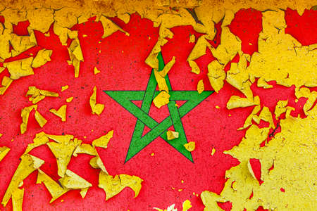 The national flag of Morocco is painted on an old metal wall with ragged paint. Country symbol.