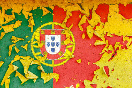 The national flag of Portugal is painted on an old metal wall with ragged paint. Country symbol.
