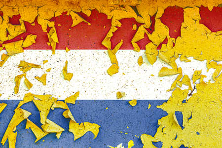 The national flag of Netherlands is painted on an old metal wall with ragged paint. Country symbol. Фото со стока