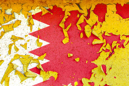 The national flag of Bahrain is painted on an old metal wall with ragged paint. Country symbol. Фото со стока
