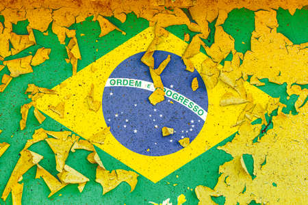 The national flag of Brazil is painted on an old metal wall with ragged paint. Country symbol.