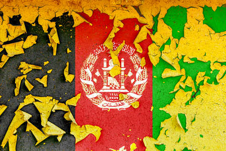 The national flag of Afghanistan is painted on an old metal wall with ragged paint. Country symbol.