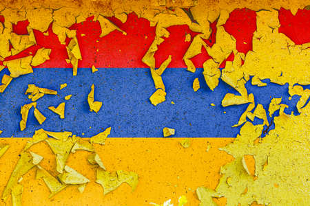 The national flag of Armenia is painted on an old metal wall with ragged paint. Country symbol. Фото со стока