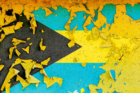 The national flag of Bahamas is painted on an old metal wall with ragged paint. Country symbol.