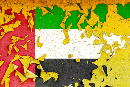 The national flag of United Arab Emirates is painted on an old metal wall with ragged paint. Country symbol.
