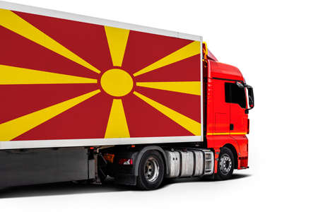 Big truck with the national flag of Macedonia on white isolated background, side view. Concept of export-import, transportation, national delivery of goods Фото со стока