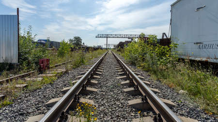 Novosibirsk / Russia - July 25 2020: railway rails, garages, warehouses, containers for storing goods.