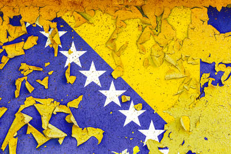 The national flag of Bosnia Herzegovina is painted on an old metal wall with ragged paint. Country symbol. Фото со стока