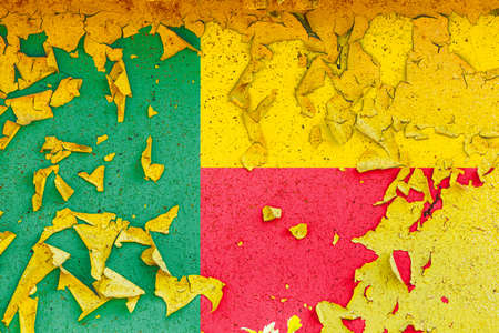 The national flag of Benin is painted on an old metal wall with ragged paint. Country symbol.