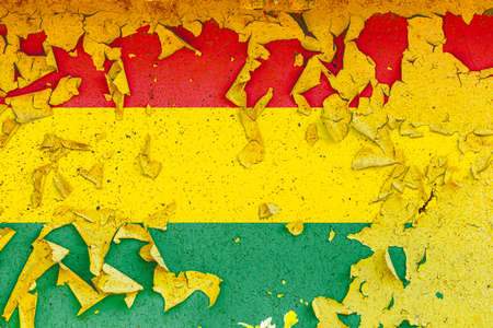 The national flag of Bolivia is painted on an old metal wall with ragged paint. Country symbol. Фото со стока