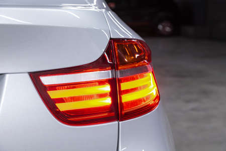 Glowing taillight of a modern car close-up