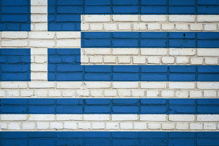 National flag of Greece depicting in paint colors on an old brick wall. Flag banner on brick wall background.