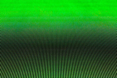 Green screen with large pixels. Pixels in macro scale of liquid crystal screen monitor, phone