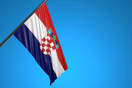 3D illustration of the national flag of Croatia on a metal flagpole fluttering against the blue sky.Country symbol.