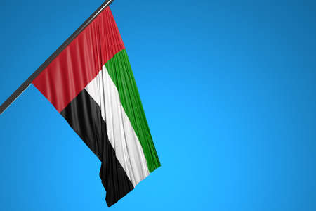 3D illustration of the national flag of United Arab Emirates on a metal flagpole fluttering against the blue sky.Country symbol.