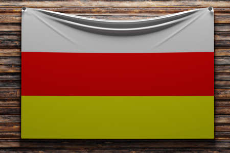 3D illustration of the national fabric flag of Ossetia nailed on a wooden wall .Country symbol.