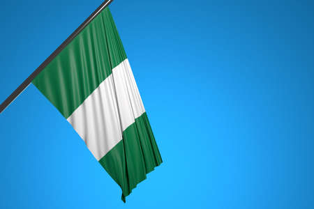 3D illustration of the national flag of Nigeria on a metal flagpole fluttering against the blue sky.Country symbol.
