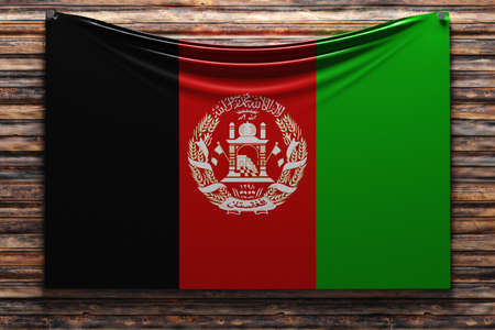 3D illustration of the national fabric flag of Afghanistan nailed on a wooden wall .Country symbol.