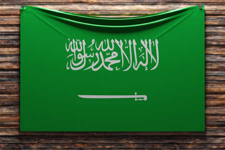 3D illustration of the national fabric flag of Saudi Arabia nailed on a wooden wall .Country symbol.