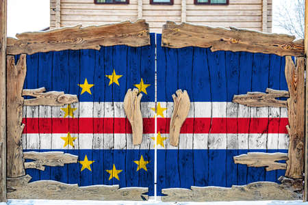 Close-up of the national flag of Cape Verde on a wooden gate at the entrance to the closed territory. The concept of storage of goods, entry to a closed area.
