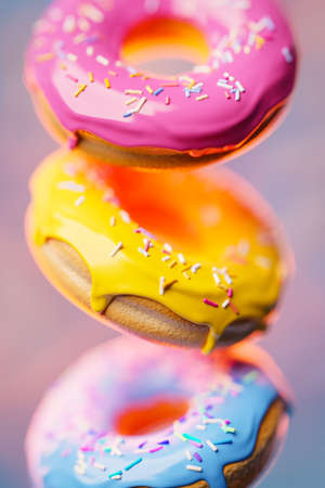 3d illustration three multi-colored donuts with multi-colored sprinkles fly in an even row on a blurred background. Cute, colorful and glossy donuts with glaze and multi-colored powder. Simple modern design. Reklamní fotografie