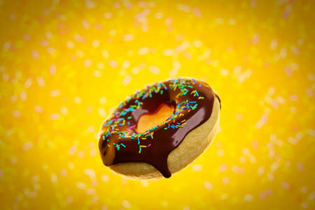 3d illustration of realistic chocolate appetizing donut with sprinkles fly on yellow background. Simple modern design. Realistic illustration.