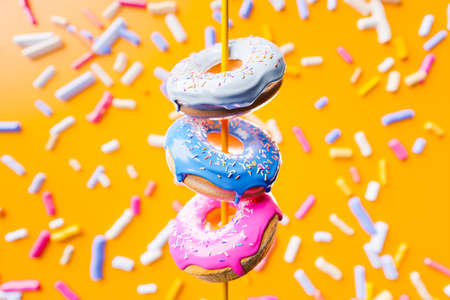 3D illustration of three multi-colored delicious appetizing donuts levitate on a yellow tasty background. Simple modern design. Realistic illustration. Reklamní fotografie