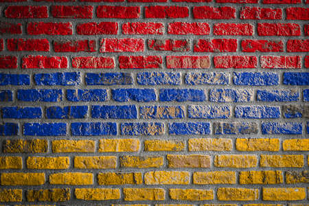 National flag of Armenia depicting in paint colors on an old brick wall. Flag banner on brick wall background. Archivio Fotografico