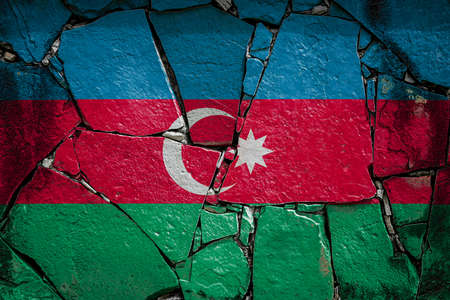 National flag of Azerbaijan depicting in paint colors on an old stone wall. Flag banner on broken wall background.