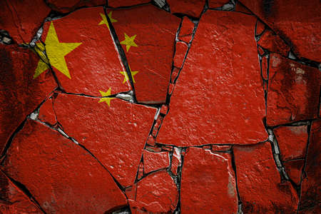 National flag of China depicting in paint colors on an old stone wall. Flag banner on broken wall background.