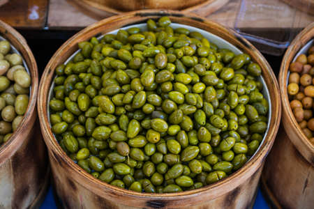 Sales of traditional products. Mediterranan olives in the market. Many bowls of olives at the farmer's market Archivio Fotografico
