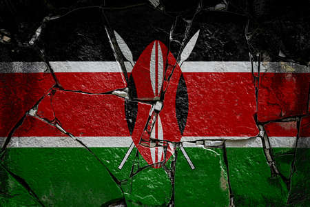 National flag of Kenya depicting in paint colors on an old stone wall. Flag banner on broken wall background.