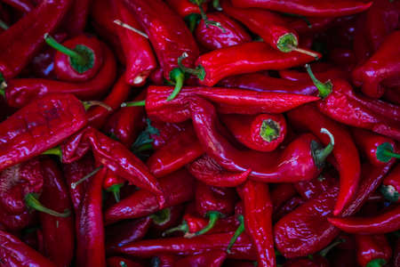 Close-up red vegetable for background, pepper texture. Red peppers form a natural shape. Fresh raw vegetables