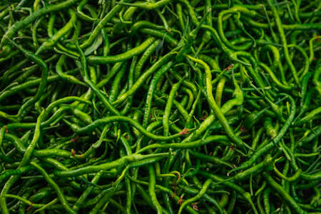 Close-up green vegetable for background, green pepper texture. Green chili peppers form a natural shape. Fresh raw vegetables Archivio Fotografico