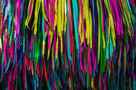 Multi-colored shoe laces are a large heap. Colorful shoelaces in shop, closeup. Stylish accessory Archivio Fotografico