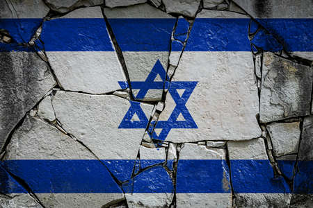 National flag of Israel depicting in paint colors on an old stone wall. Flag banner on broken wall background. Stock fotó