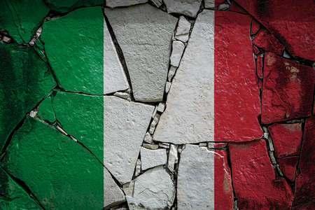 National flag of Italy depicting in paint colors on an old stone wall. Flag banner on broken wall background.