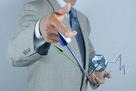 businessman hand drawing a pie chart and 3d graph photo