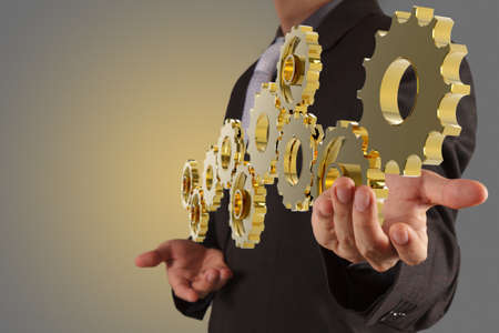businessman hand show gear to success as concept Stock Photo - 16704321