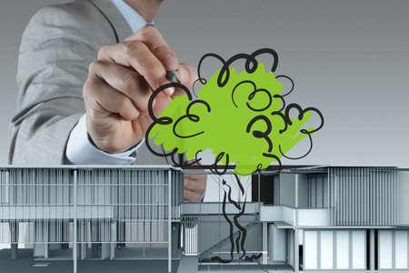 businessman draws building development concept Stock Photo - 16695440