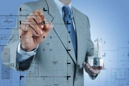 businessman draws building development concept Stock Photo - 16695438