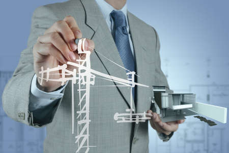 businessman draws building development concept Stock Photo - 16695310