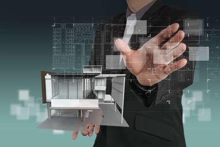 businessman draws building development concept