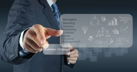 performance management: businessman hand points to business strategy as concept Stock Photo