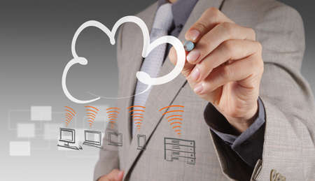 Businessman drawing a Cloud Computing diagram on the new computer interface Stock Photo - 16707262