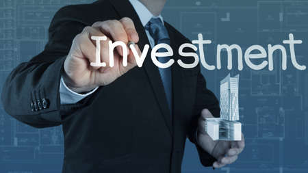 businessman hand pointing to investment concept Stock Photo - 16706324